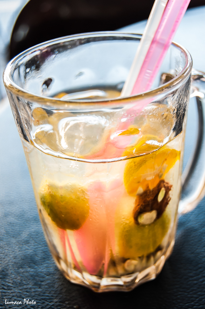 Kit Zai Bing (桔子冰) - Key Lime Ice Drink is a very popular local drink in Kota Kinabalu, made with local variety of Key Lime, Salted Plum and sugar. The local believe this drink can reduce heat in a person's body. It is a local favorite. Location: Kota Kinabalu, Sabah, Malaysia.