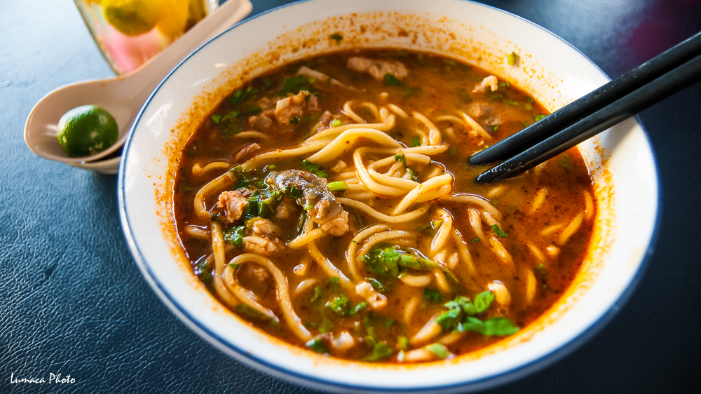 A bowl of Spicy Laksa Noodle Soup, a local favorite, it's spicy, creamy, and aromatic, it will give you a good sweat after, feel surpricingly good in the hot temparature. Location: Kota Kinabalu, Sabah, Malaysia